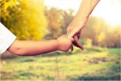 Parent & child holding hands