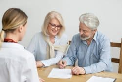 older couple meeting with will writing solicitors in faversham